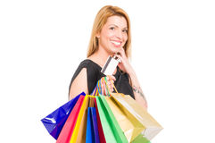 Shopping woman holding shopping bags and credit or debit card Stock Image