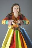 Shopping woman holding shopping bags. Stock Photos