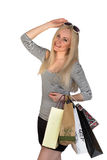 Shopping woman holding shopping bags isolated. Shopping woman holding shopping bags and smiling - isolated in striped t-shirt on the white background Stock Photography