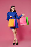 Shopping woman holding shopping bags l on pink background Stock Photography