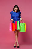 Shopping woman holding shopping bags l on pink background Stock Image