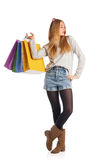 Shopping woman holding shopping bags Stock Images
