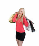 Shopping woman holding shopping bags and smiling. Isolated on white background stock photo