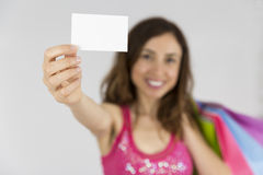 Shopping woman holding up a sign card with copy space Stock Photography