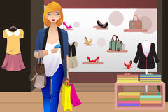 Shopping woman inside the clothing store. A vector illustration of shopping woman inside the clothing store holding a credit card Royalty Free Stock Photography