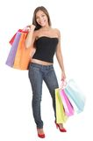 Shopping woman isolated. In full length on white background. Gorgeous multiracial Chinese Asian / Caucasian young woman model in her twenties Stock Photo