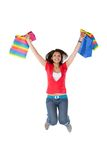 Shopping woman jumping Stock Images