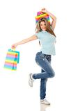 Shopping woman jumping Stock Photos