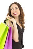 Shopping woman looking back while carrying shooping bags Stock Photos