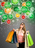 Shopping woman looking at discounts Stock Photography