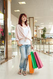 Shopping woman in mall Stock Images