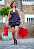 Shopping woman outdoors Stock Photo