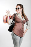 Shopping woman over white background. Shopping happy woman over white background Royalty Free Stock Images