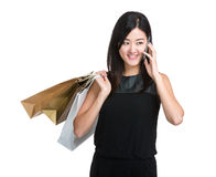 Shopping woman with paper bag and mobile phone Stock Image
