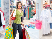 Shopping woman with paper bags. Royalty Free Stock Image