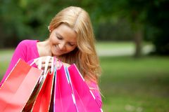 Shopping woman peeking Stock Photography