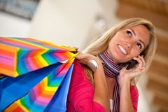 Shopping woman on the phone Royalty Free Stock Photos