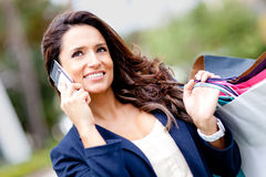 Shopping woman on the phone Stock Photos