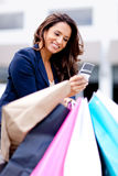 Shopping woman on the phone Royalty Free Stock Photo