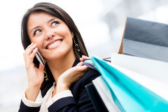 Shopping woman on the phone Stock Images