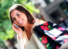 Shopping woman on the phone Royalty Free Stock Image