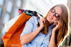 Shopping woman on the phone Stock Image