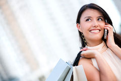 Shopping woman on the phone Royalty Free Stock Photography