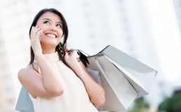 Shopping woman on the phone Stock Photo