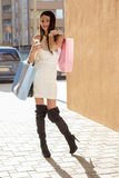 Shopping woman with phone Stock Images