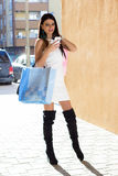Shopping woman with phone Royalty Free Stock Photography