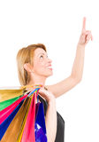 Shopping woman pointing finger up Royalty Free Stock Images