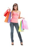 Shopping woman pointing full body isolated royalty free stock images