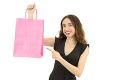 Shopping woman pointing to shopping bag with copy space Royalty Free Stock Photo