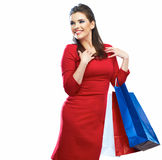 Shopping woman portrait isolated. Shopping bags. White backgrou Stock Photo
