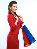 Shopping woman portrait isolated. Shopping bags. White backgrou Royalty Free Stock Images