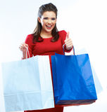 Shopping woman portrait . White background. Happy shopp. Ing girl. Red dress. female beautiful model Stock Photo