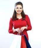 Shopping woman portrait . White background. Happy shopp. Ing girl. Red dress. female beautiful model Royalty Free Stock Photo