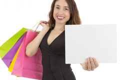 Shopping woman presenting a marketing board Royalty Free Stock Image