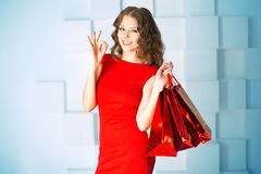 Shopping woman with red bags, presents in mall. shopping center. Stock Image