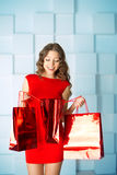 Shopping woman with red bags, presents in mall. shopping center. Royalty Free Stock Images