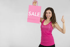 Shopping woman sales sign and giving thumbs up Royalty Free Stock Images