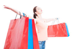 Shopping woman satisfied and happy having arms wide opened conce Stock Photos