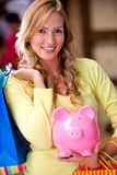 Shopping woman saving money Royalty Free Stock Photo