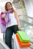 Shopping woman on scalators Stock Photo