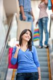 Shopping woman on scalators Royalty Free Stock Image
