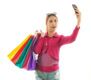 Shopping woman self photographing Royalty Free Stock Images