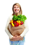 Shopping woman. Senior shopping woman with grocery items . Isolated over white background Royalty Free Stock Photo