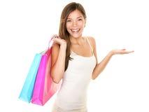 Shopping woman showing Stock Photo