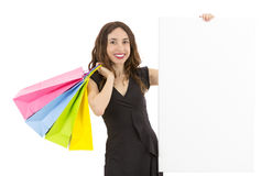 Shopping woman showing blank advertisement board Royalty Free Stock Image