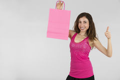 Shopping woman showing copy space and giving thumbs up Royalty Free Stock Images